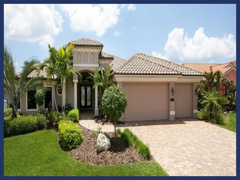 Beautiful luxury villa overlooks waterway-Boats dock-4 bedrooms-Pet friendly- Water features pool - Image 1 - Matlacha - rentals