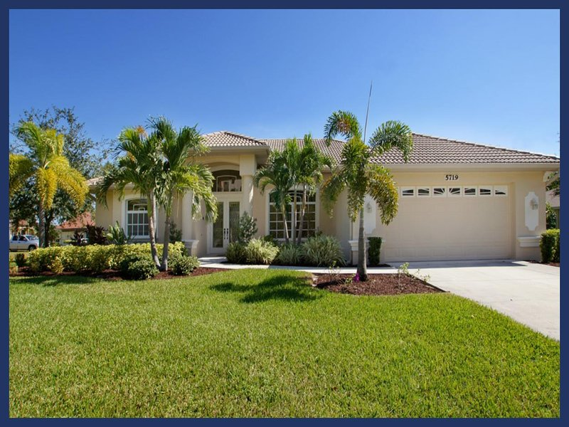 Pool- Boat dock- Delightful 3 bedroom luxury villa- On water way- Elegantly decorated- Pet friendly - Image 1 - Cape Coral - rentals