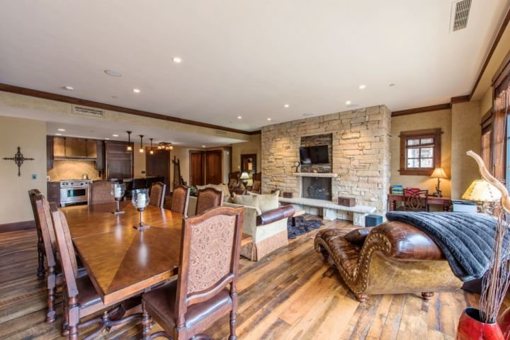 Relax each day in designer leather furnishings or warm up next to the custom fieldstone fireplace with floor to ceiling windows and views of Deer Va - Arrowleaf at Empire Pass in Deer Valley - Park City - rentals