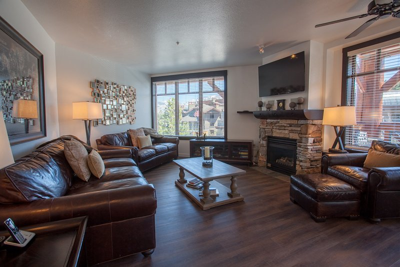 Living Room - 2 sofas (one is a Queen Sleeper Sofa), Chair with Ottoman, Love Seat, Flat screen TV - Village # 2230 - White Mountain Lodge - Mammoth Lakes - rentals