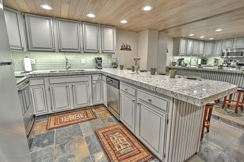 Newly Remodeled Kitchen with stainless appliances, full kitchen, Granite counters, and bar seating in Snowblaze 302 - Park City - Snowblaze 302 - Park City - rentals