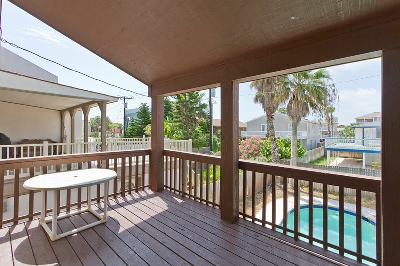 South facing balcony overlooking the private pool - 127B E. Hibiscus - South Padre Island - rentals