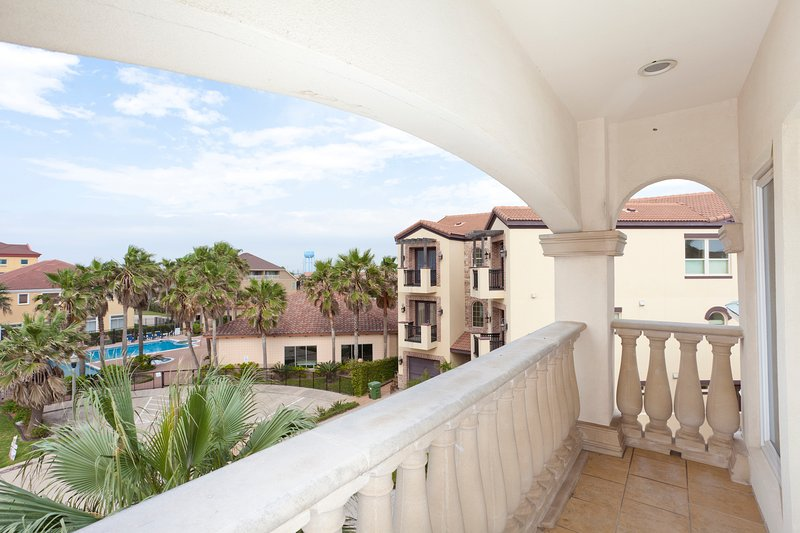 Balcony with view to the swimming pool area. - 6508 B-Fountainway - South Padre Island - rentals