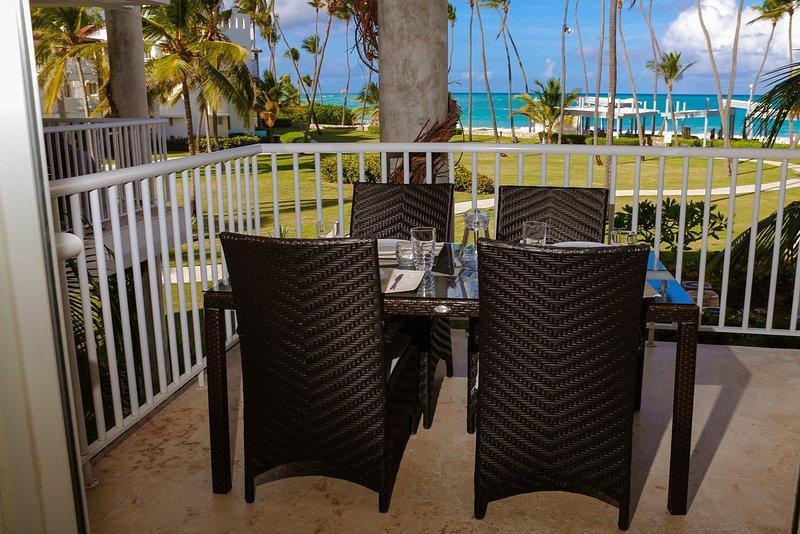 Enjoying beachfront view and breeze from the Balcony  - Beautiful BeachFront Condo + Maid Service (Renovated in NOV 2016!!) - Punta Cana - rentals