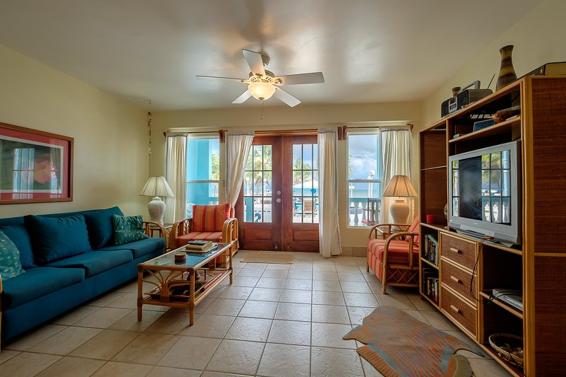 Ample living room leading directly to front porch and pool and beach beyond! - Adorable 1 bedroom condo on private beach! -A2 - San Pedro - rentals