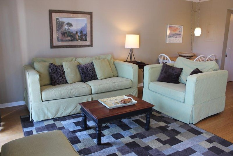 The bright, airy and comfy living room in this studio includes a sleeper sofa. - Beachfront II 102A 30A - Seagrove Beach - rentals
