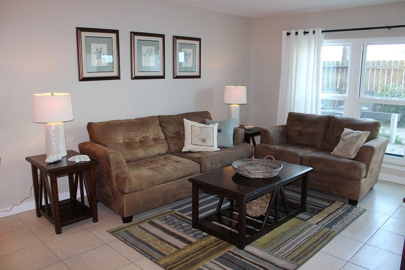 Cozy living area with open floor plan. - Emerald Isle 102 Okaloosa Island - Okaloosa Island - rentals