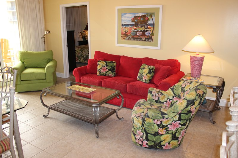 The professionally decorated living room features access to the balcony with gulf-side views and a new sleeper sofa. - Waters Edge 302 Okaloosa Island - Fort Walton Beach - rentals