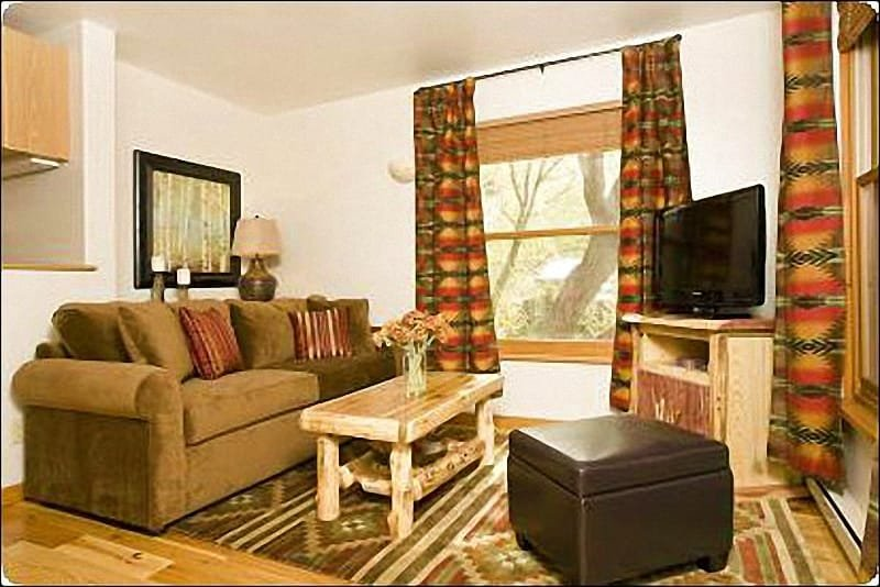 Living Room Features a Flat-Screen TV, Sleeper Sofa, and Creek Views - Recently Upgraded Condo - Along the Banks of Flat Creek (6949) - Jackson - rentals