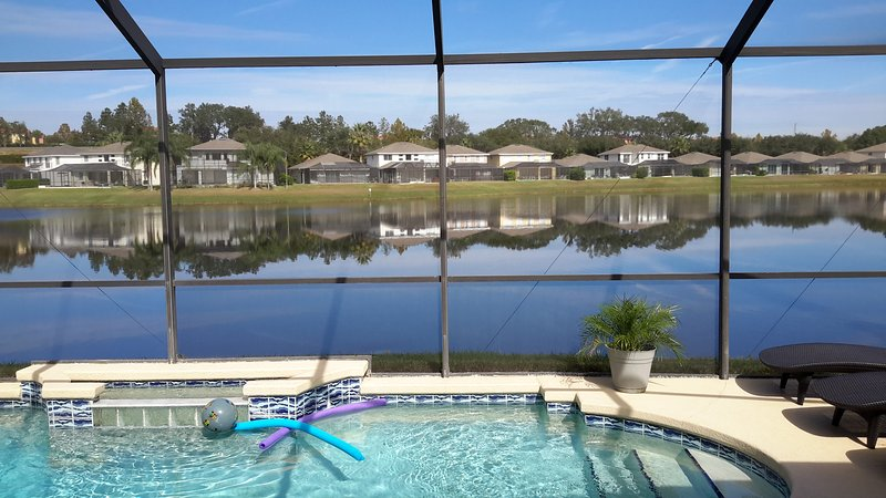 Another beautiful day!  View from INSIDE looking out with triple slider doors open = AWESOME! - Tropical Lakefront Villa, Pet-Friendly and only 5 mins to Disney - Kissimmee - rentals