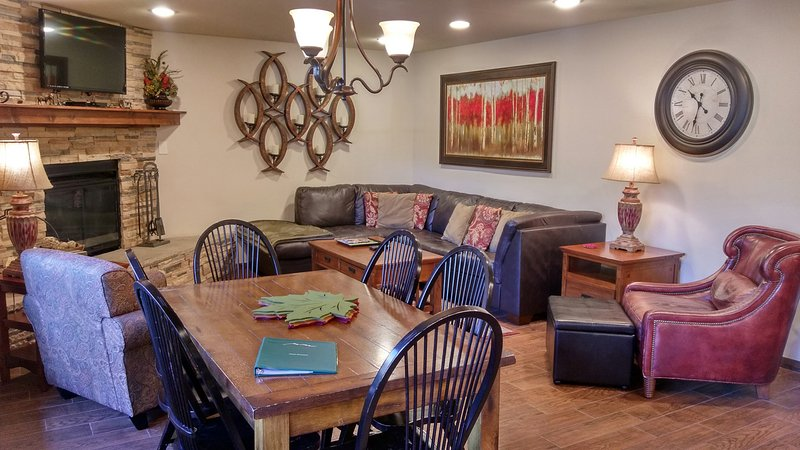 BC West Condo S-1 living room with sofa bed, gas fireplace, dining table, and patio w/ gas BBQ - BC West S-1 w/ FREE Skier Shuttle - Avon - rentals
