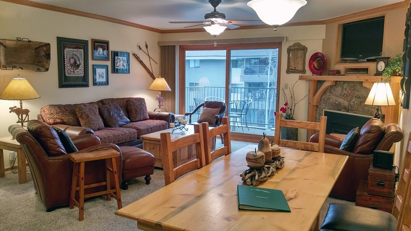 BC West Condo B-3 Living room with sofa bed, gas fireplace, dining table, and balcony w/ gas BBQ - BC West B-3 w/ FREE Skier Shuttle - Avon - rentals