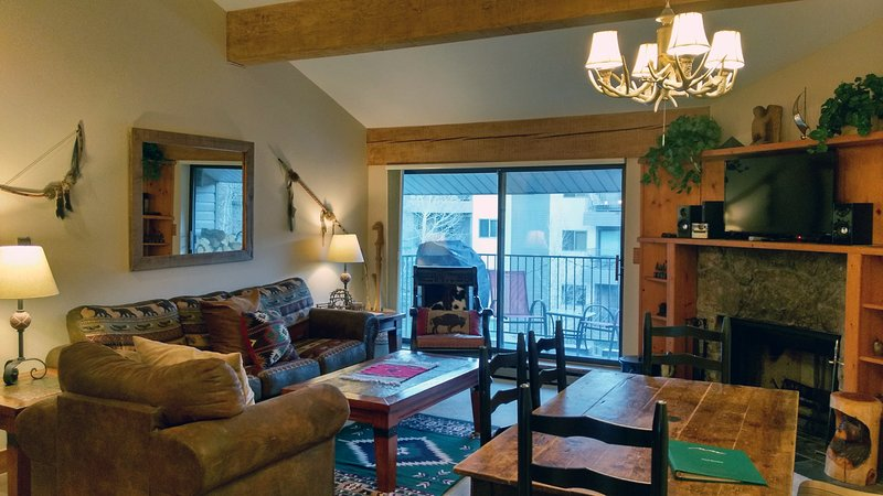 BC West Condo O4 living room with sofa bed, wood fireplace, dining table, and balcony w/ gas BBQ - BC West O-4 w/ FREE Skier Shuttle - Avon - rentals