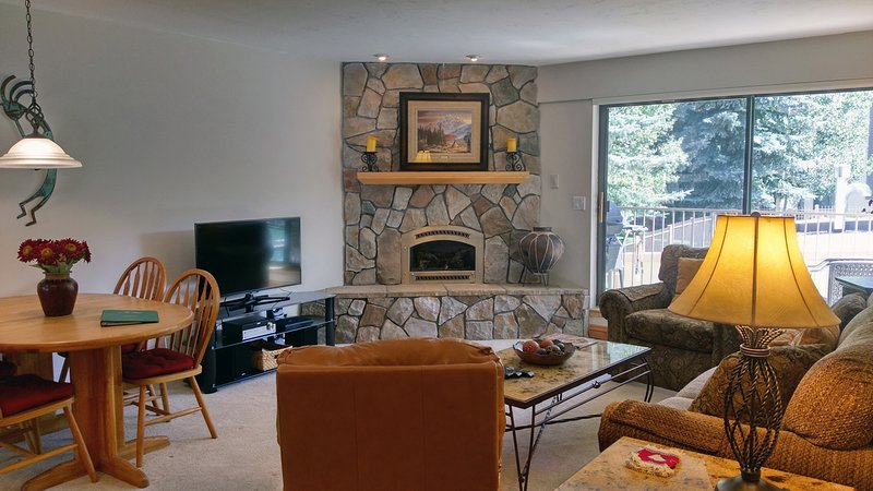 Beaver Creek West N-2 living room with sofa bed, gas fireplace, dining table, and balcony w/ gas BBQ - BC West N-2 w/ FREE Skier Shuttle - Avon - rentals