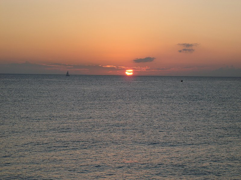 Glorious sunset from the balcony - 7 Mile Beach Front Condo right on Ocean, Pvt Beach - Seven Mile Beach - rentals