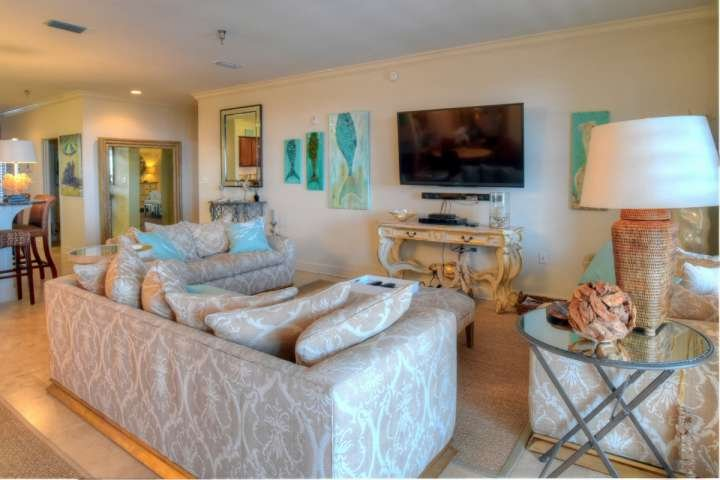 Open Living Area with plenty of seating with access to the over-sized balcony - Charming Penthouse with 4 Bedrooms and Pool near Beach - Panama City Beach - rentals