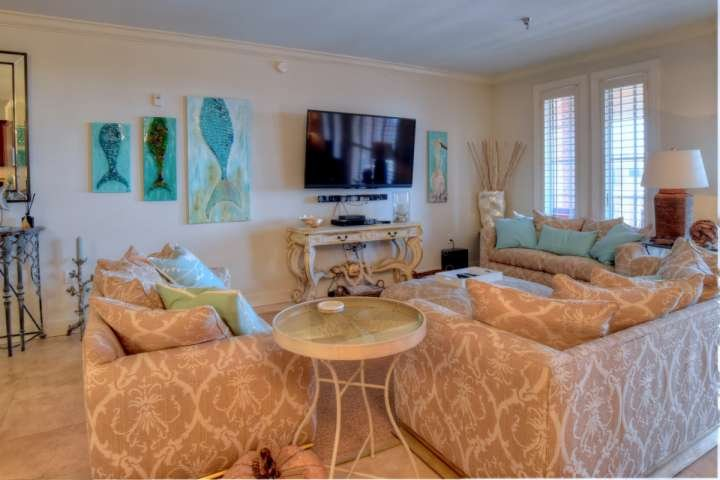 Living Room with Flatscreen TV - Charming Penthouse with 4 Bedrooms and Pool near Beach - Panama City Beach - rentals