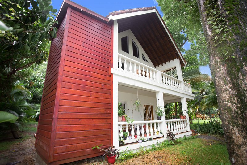 Exterior view of our duplex.  2nd floor is a 2 bedroom + loft with 1 bath rental we lovingly call Yellow Flower Upper - Yellow Flower House Upper - Roatan - rentals