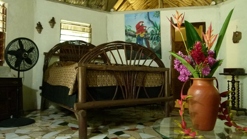 Interior of Macaw Cabana with queen size bed, private hot and cold shower, mosaic tile floor - Macaw Bank Jungle Lodge - The Macaw Cabana - San Ignacio - rentals