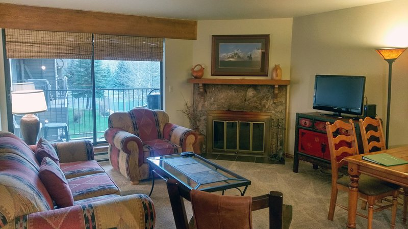 BC West Condo G-2 living room with sofa bed, wood fireplace, dining table, and balcony w/ gas BBQ - BC West G-2 w/ FREE Skier Shuttle - Avon - rentals