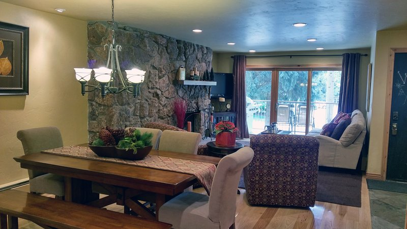 Living room w/ sofa bed, wood fireplace, dining table, and balcony w/ gas BBQ - BC West 14 w/ FREE Skier Shuttle - Avon - rentals