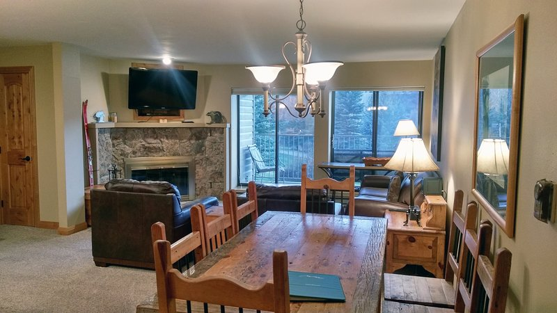 BC West Q-2 living room with sofa bed, wood fireplace, dining table, and balcony with gas BBQ - BC West Q-2 w/ FREE Skier Shuttle - Avon - rentals