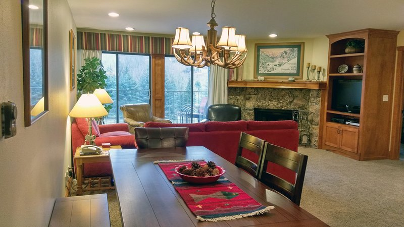 BC West Condo A-3 Living room with sofa bed, dining table, wood fireplace, and balcony w/  gas BBQ - BC West A-3 w/ FREE Skier Shuttle - Avon - rentals