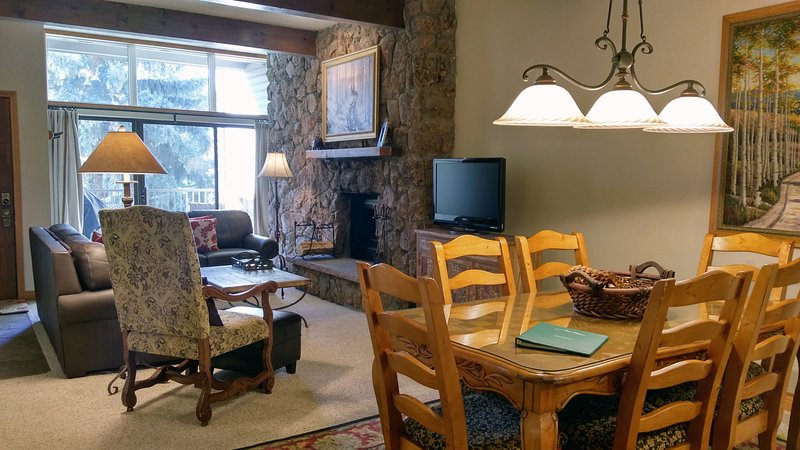 Living room w/ sofa bed, wood fireplace, dining table, and balcony w/ gas BBQ - BC West 13 w/ FREE Skier Shuttle - Avon - rentals