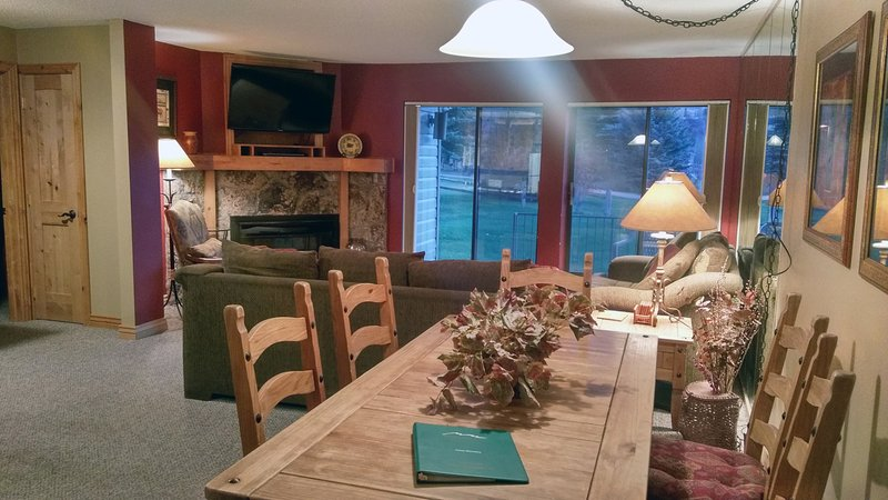 Beaver Creek West Q-1 living room with sofa bed, gas fireplace, dining table, and patio w/ gas BBQ - BC West Q-1 w/ FREE Skier Shuttle - Avon - rentals