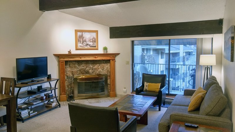 BC West Condo H-4 Living room with sofa bed, wood fireplace, dining table, and balcony w/ gas BBQ - BC West H-4 w/ FREE Skier Shuttle - Avon - rentals