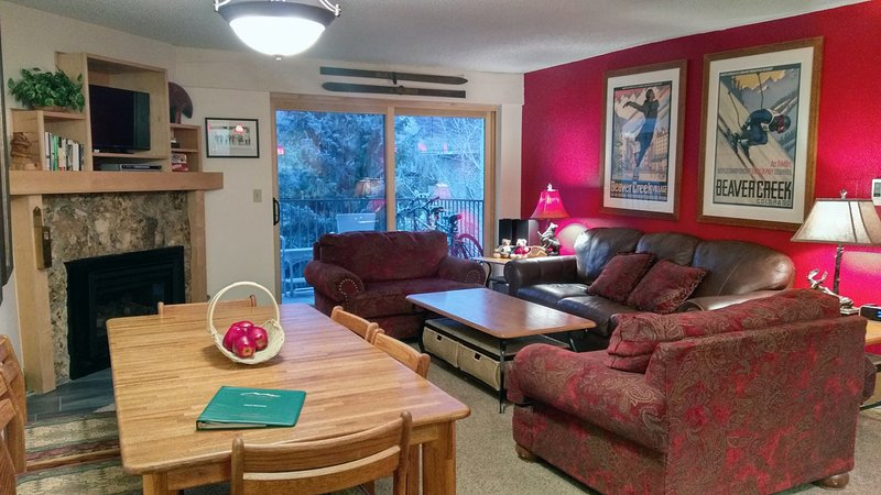 BC West Condo H-3 Living room with sofa bed, gas fireplace, dining table, and balcony w/ gas BBQ - BC West H-3 w/ FREE Skier Shuttle - Avon - rentals