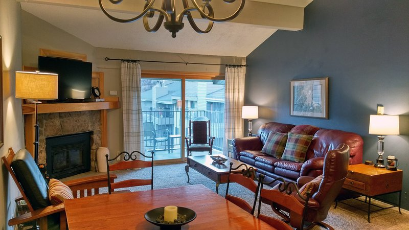BC West Condo J4 Living room w/ sofa bed, gas fireplace, dining table, and balcony w/ gas BBQ - BC West J-4 w/ FREE Skier Shuttle - Avon - rentals