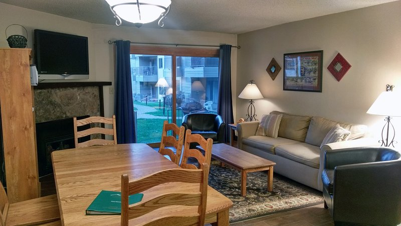 BC West Condo J-1 living loom with sofa bed, gas fireplace, dining table, and patio w/ gas BBQ - BC West J-1 w/ FREE Skier Shuttle - Avon - rentals