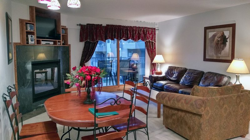 Beaver Creek West Condo J-2 living room with gas fireplace, dining table, and balcony w/ gas BBQ  - BC West J-2 w/ FREE skier Shuttle - Avon - rentals