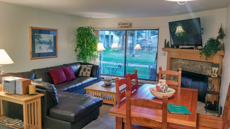 BC West Condo I-1 living room with sofa bed, dining table, gas fireplace, and patio with gas BBQ - BC West I-1 w/ FREE Skier Shuttle - Avon - rentals