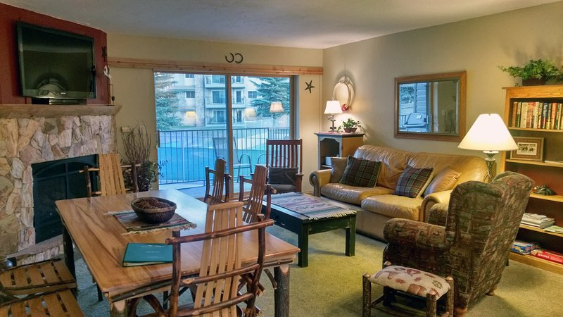 Beaver Creek West P-2 living room with sofa bed, gas fireplace, dining table, and balcony w/ gas BBQ - BC West P-2 w/ FREE Skier Shuttle - Avon - rentals