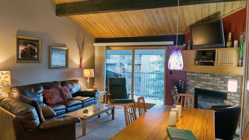 Beaver Creek West Condo M-4 living room with gas fireplace, dining table, and balcony w/ gas BBQ - BC West M-4 w/ FREE Skier Shuttle - Avon - rentals