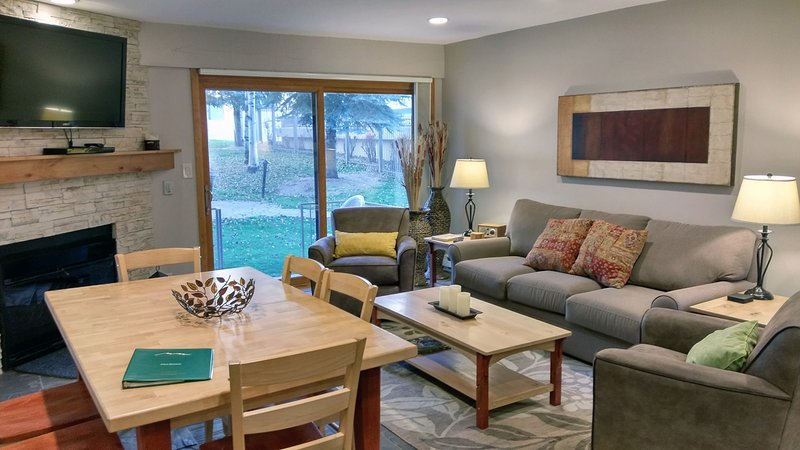 Beaver Creek West L-1 living room with sofa bed, gas fireplace, dining table, and patio w/ gas BBQ - BC West L-1 w/ FREE Skier Shuttle - Avon - rentals