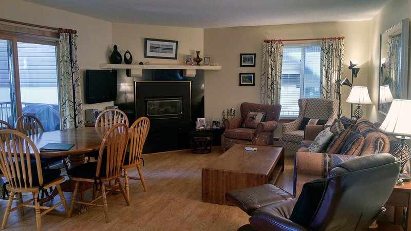 BC West Condo U-1 living room with sofa bed, gas fireplace, dining table, and patio w/ gas BBQ - BC West U-1 w/ FREE Skier Shuttle - Avon - rentals