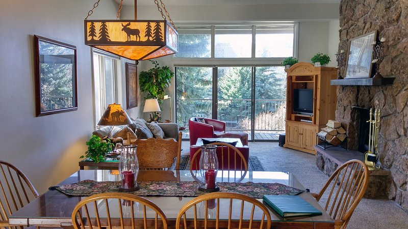Beaver Creek West Condo #9 living room with wood fireplace, dining table, and  balcony with gas BBQ - BC West 9 w/ FREE Skier Shuttle - Avon - rentals