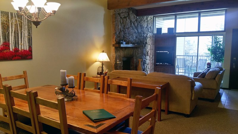 Living room w/ sofa bed, wood fireplace, dining table, and balcony w/ gas BBQ - BC West 12 w/ FREE Skier Shuttle - Avon - rentals