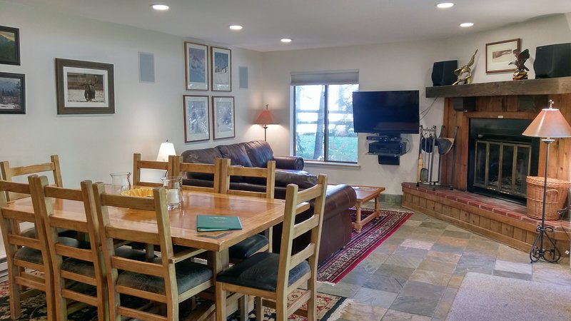 BC West Condo W-1 living room with sofa bed, wood fireplace, dining table, and patio w/ gas BBQ - BC West W-1 w/ FREE Skier Shuttle - Avon - rentals