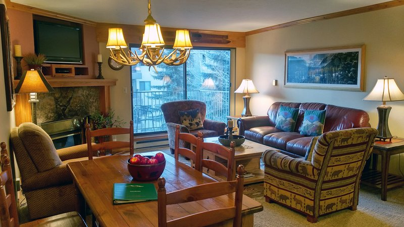 BC West Condo C3 Living room with sofa bed, gas fireplace, dining table, and balcony w/gas BBQ - BC West C-3 w/ FREE Skier Shuttle - Avon - rentals
