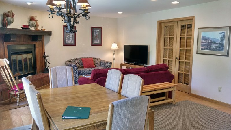 BC West Condo Y-1 living room with sofa bed, wood fireplace, dining table, and patio w/ gas BBQ - BC West Y-1 w/ FREE Skier Shuttle - Avon - rentals