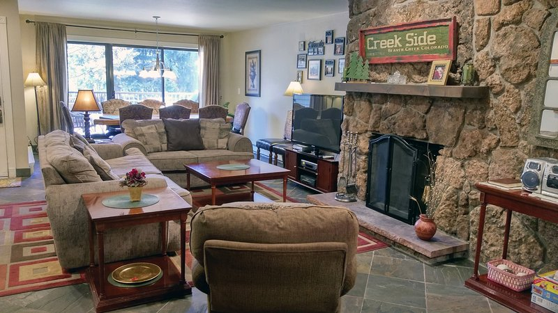 Beaver Creek West Condo #11 Living room with wood fireplace, dining table, and balcony with gas BBQ - BC West 11 w/ FREE Skier Shuttle - Avon - rentals