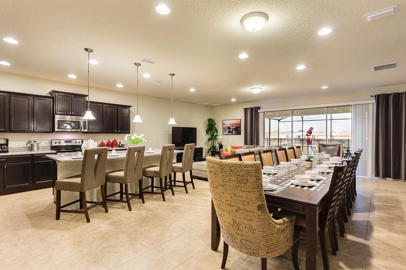 Dining and Kitchen area - New Opening 9 Br/6 Ba luxurious Pool House from $299/nt, Close To Disney - Kissimmee - rentals