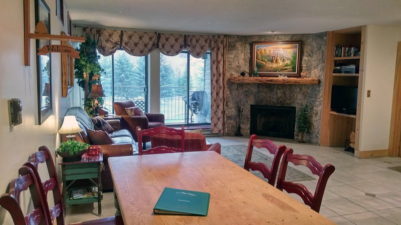 Beaver Creek West Condo A-2 Living room with wood fireplace, dining table, and balcony w/ gas BBQ - BC West A-2 w/ FREE Skier Shuttle - Avon - rentals