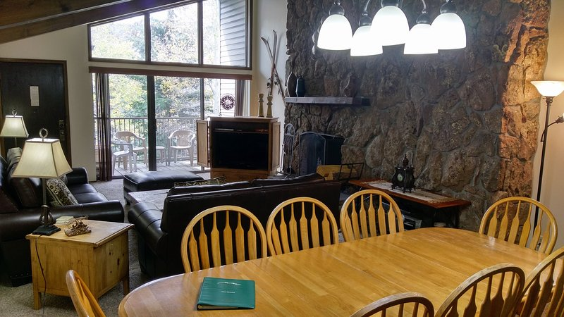 BC West #27 Living room w/ wood fireplace, dining table, and balcony w/ gas BBQ - BC West 27 w/ FREE Skier Shuttle - Avon - rentals