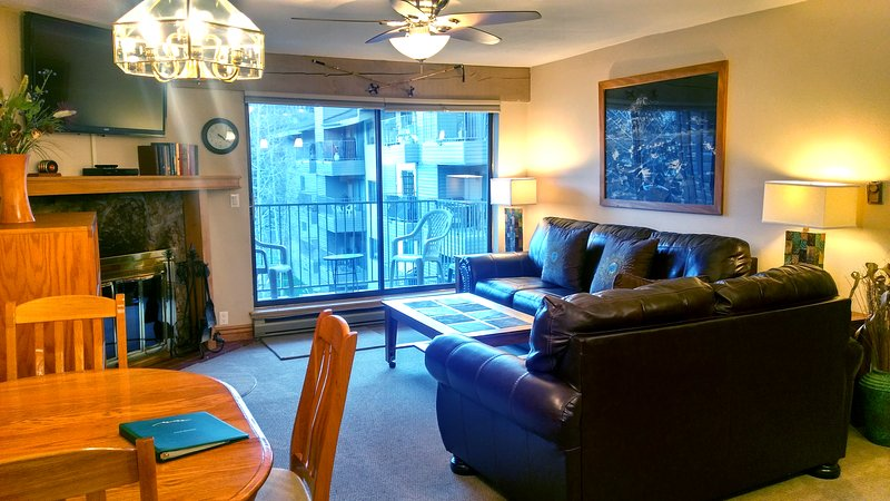 Beaver Creek West J-3 Living room w/ dining table, wood fireplace, and balcony w/ gas BBQ - BC West J-3 w/ FREE Skier Shuttle - Avon - rentals