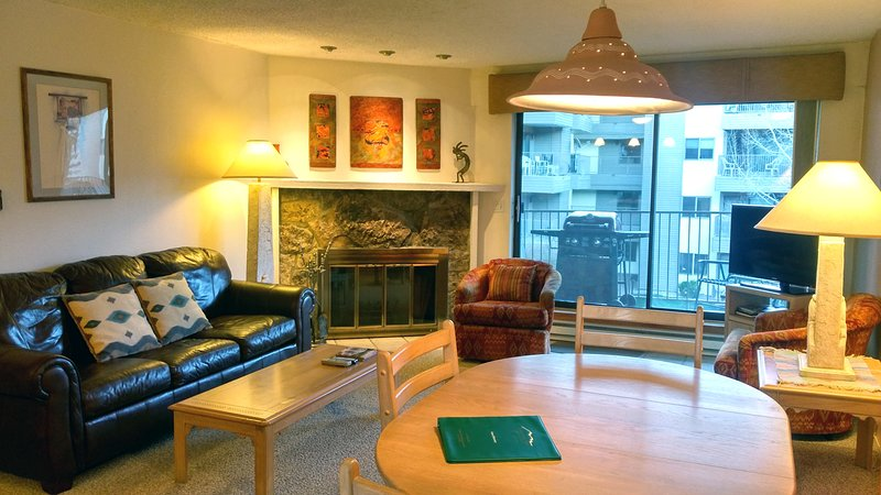 BC West Condo L-3 living room w/ sofa bed, wood fireplace, dining table, and balcony w/ gas BBQ - BC West L-3 w/ FREE Skier Shuttle - Avon - rentals